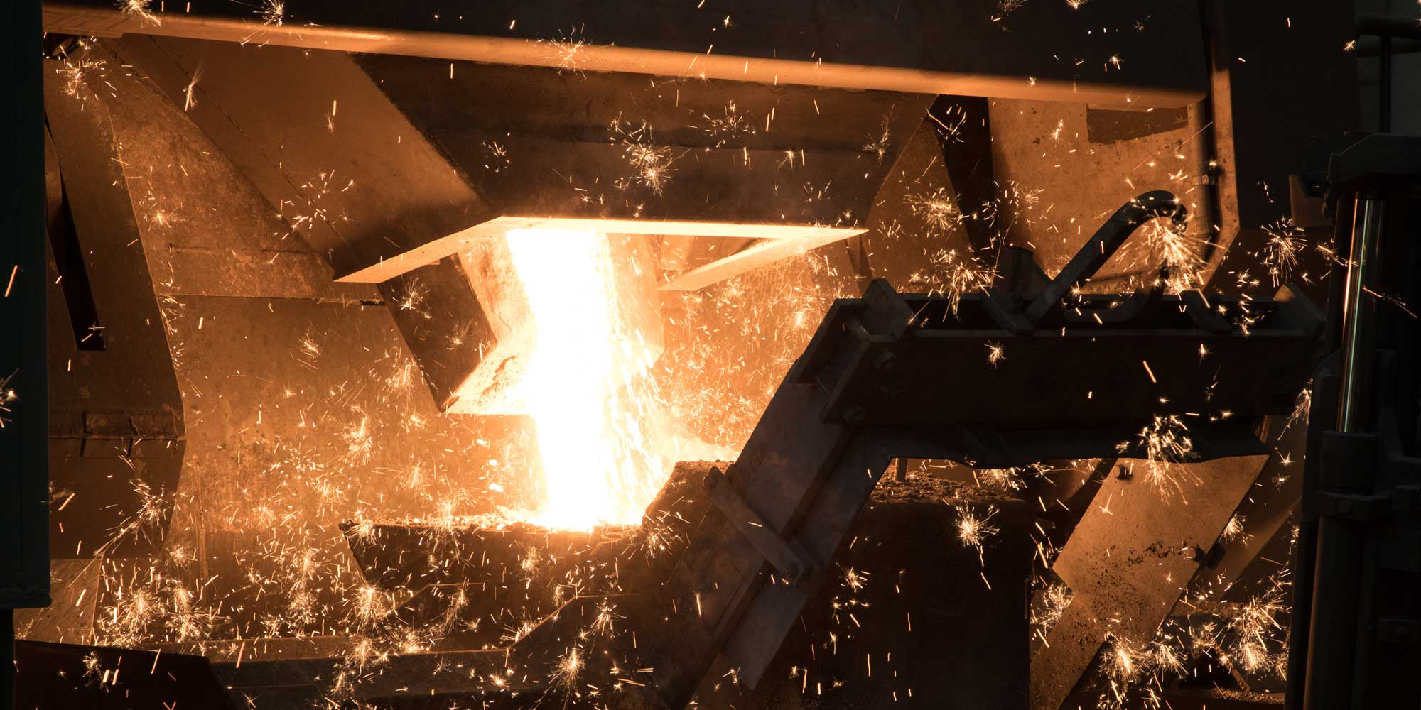 Liquid iron flows out of the furnace